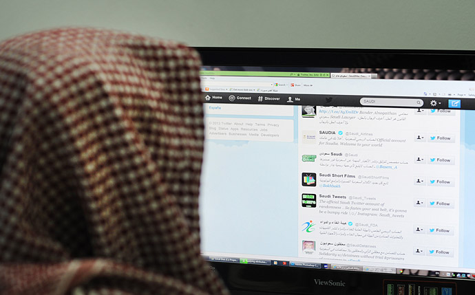 A Saudi man browses through twitter on his desktop in Riyadh (AFP Photo)