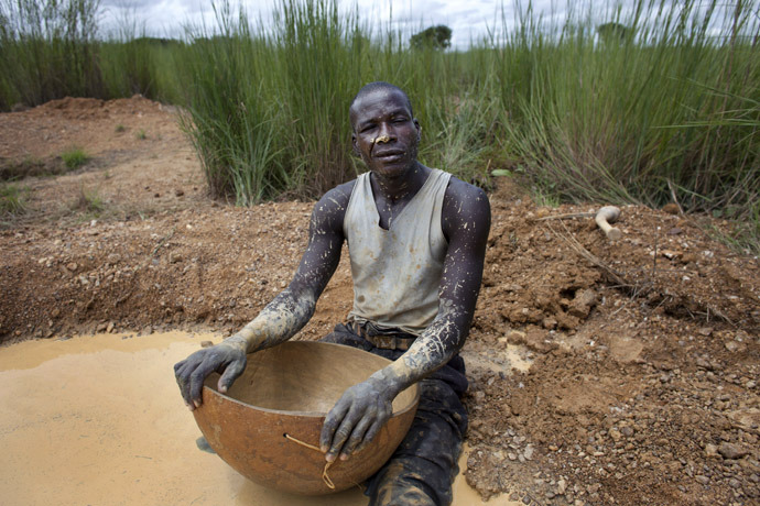 Artisanal gold miner Mamadou Diarra poses for a picture in between panning for gold at a small scale mine in Kalana (Reuters)