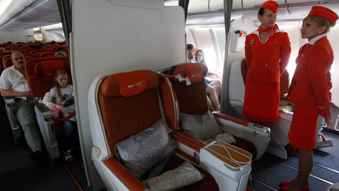 People sit onboard an Aeroflot Airbus A330 heading to the Cuban capital Havana at Moscow's Sheremetyevo airport June 27, 2013.(Reuters / Maxim Shemetov)
