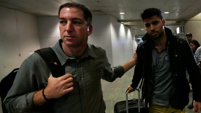 U.S. journalist Glenn Greenwald (L) walks with his partner David Miranda in Rio de Janeiro's International Airport August 19, 2013. (Reuters / Ricardo Moraes)
