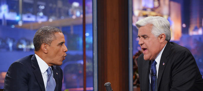 "US President Barack Obama chats with host Jay Leno during a taping of ""The Tonight Show with Jay Leno"" at NBC Studios on August 6, 2013 (AFP Photo / Mandel Ngan)"