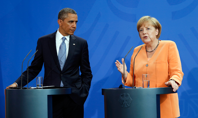 U.S. President Barack Obama and German Chancellor Angela Merkel hold a joint news conference at the Chancellery in Berlin June 19, 2013 (Reuters / Kevin Lamarque)