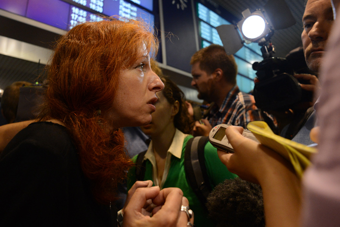 Tanya Lokshina, Deputy Director of Human Rights Watch's Moscow office, speaks with journalists before his meeting with US National Security Agency (NSA) fugitive leaker Edward Snowden inside the terminal F of Moscow's Sheremetyevo airport, on July 12, 2013 (AFP Photo / Kirill Kudryavtsev)
