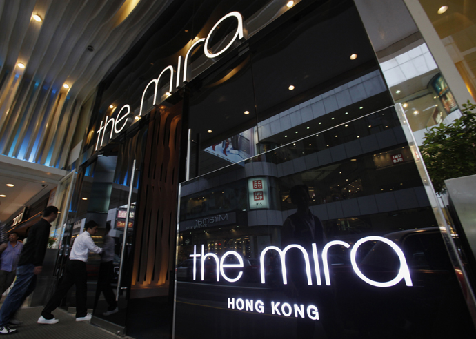Visitors walk into The Mira Hotel, where 29-year-old former CIA employee Edward Snowden was reported to have checked out of on Monday, in Hong Kong June 10, 2013. (Reuters / Bobby Yip)