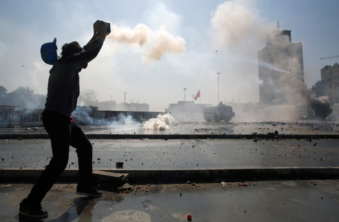 A police water cannon vehicle burns after a protester fired fireworks with a home made device against riot police and water cannons in Istanbul's Taksim square June 11, 2013 (Reuters / Yannis Behrakis)