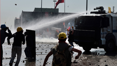 Riot police fire water cannon at protester in wheelchair at Taksim