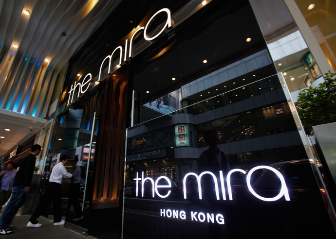 Visitors walk into The Mira Hotel, where 29-year-old former CIA employee Edward Snowden was reported to have checked out of on Monday, in Hong Kong June 10, 2013 (Reuters / Bobby Yip)