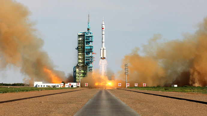 China launches lunar probe with first moon rover aboard