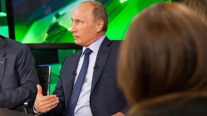 Russian President Vladimir Putin, center, during his talk with Russia Today television channel's journalists and correspondents, June 11, 2013. (RT photo / Semyon Khorunzhy)