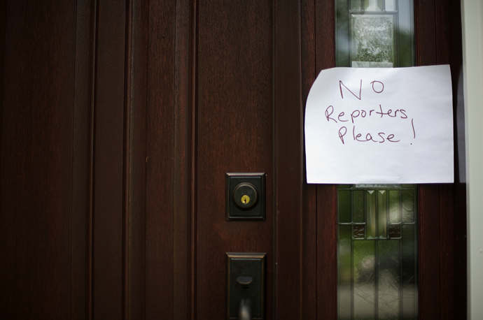 "A sign reading ""No Reporters Please"" is posted on the front door of the house belonging to Lonnie and Karen Snowden, father and stepmother of NSA whistle-blower Edward Snowden, in Upper Macungie Township, Pennsylvania June 11, 2013. (Reuters / Mark Makela)"