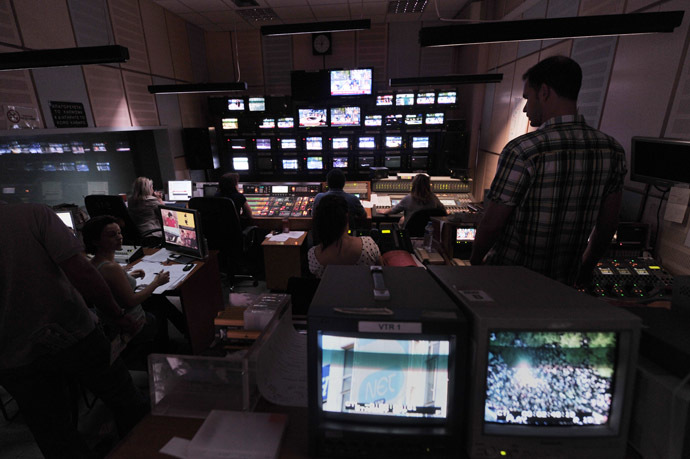 Greece's public TV employees broadcast a Web-Tv signal in a control room at the ERT headquarters in Athens on June 12, 2013, a day after a shock decision by the government to shut down the state broadcaster's operations with immediate effect, a move affecting nearly 2,700 jobs. (AFP Photo)