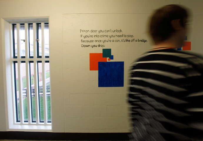 A prisoner passes poetry written on a wall in Doncaster Prison, northern England (Reuters / Darren Staples)