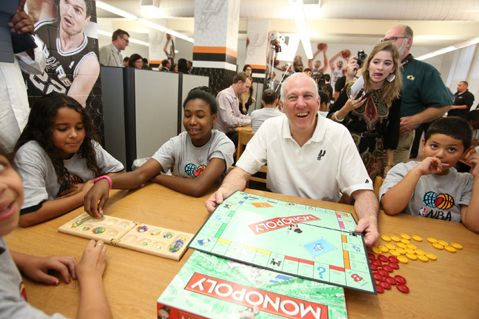 Head Coach Gregg Popovich of the San Antonio Spurs interacts with the kids at the 2013 NBA Cares Legacy Project as part of the 2013 NBA Finals on June 7, 2013 at the Wheatley Middle School in San Antonio, Texas (NBAE Nathaniel S. Butler / NBAE via Getty Images / AFP)