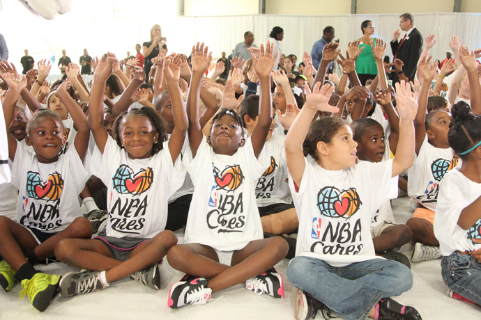 Kids celebrate being at the 2013 NBA Finals Legacy Project as part of the 2013 NBA Finals on June 7, 2013 at the Joe Celestin Center in Miami, Florida (NBAE Nathaniel S. Butler / NBAE via Getty Images / AFP)