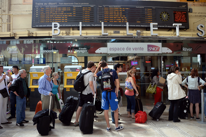 People look at an information board at the Saint Charles train station during a strike by French SNCF state-owned railway company employees on June 13, 2013, in Marseille (AFP Photo / Anne-Christine Pououlat)
