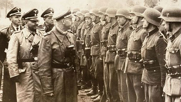 Heinrich Himmler, center, as he reviews troops of the Galician SS-Volunteer Infantry Division, June 3, 1944.(Photo from Holocaust Memorial Museum)