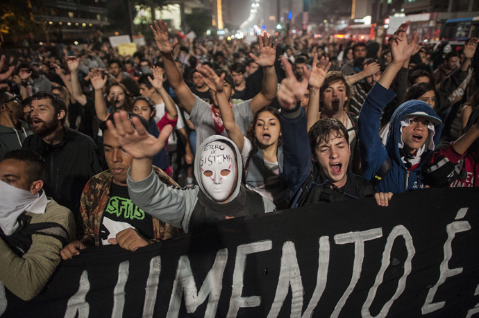 Students protest against the rise in public bus and subway fares from 3 reais to 3.20 reais (1.50 USD) in Sao Paulo on June 11, 2013. (AFP Photo/Nelson Almeida)