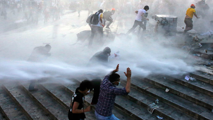 Tear gas and bulldozers: Istanbul riot police clear Gezi Park protest camp