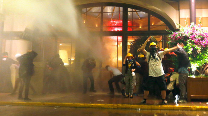 Protesters are attacked by police water cannon and tear gas in front of a hotel where they took shelter next to Gezi Park near Istanbul's Taksim square June 15, 2013.(Reuters / Yannis Behrakis )
