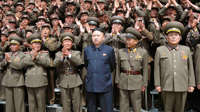 North Korean leader Kim Jong-un (C) poses with troops of Korean People's Army Unit 405 at an undisclosed location in this picture released by the North Korea's KCNA news agency in Pyongyang.(Reuters / KCNA)