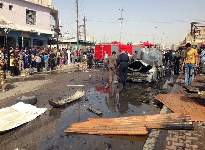 Iraqis gather at the scene of an explosion in Nasiriyah, south of the Iraqi capital Baghdad on June 16, 2013. (AFP Photo/Amer Karim)