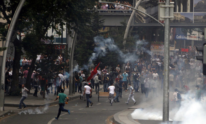 People run to avoid tear gas during protests at Kizilay square in central Ankara, June 16, 2013. (Reuters)