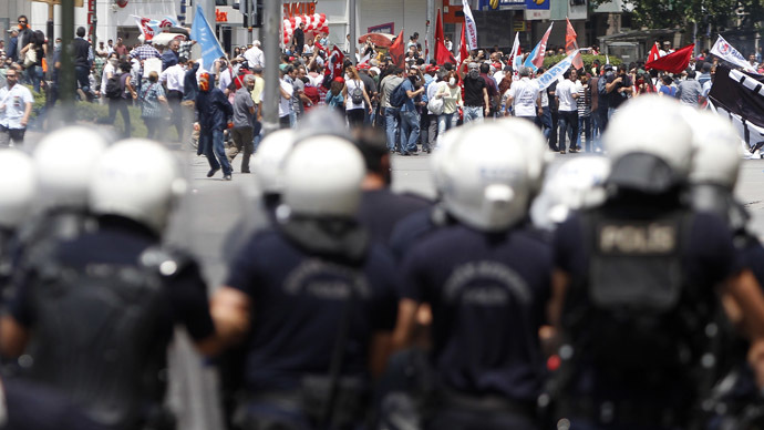 Protesters are confronted by police during a demonstration at Kizilay square in central Ankara June 16, 2013. (Reuters)