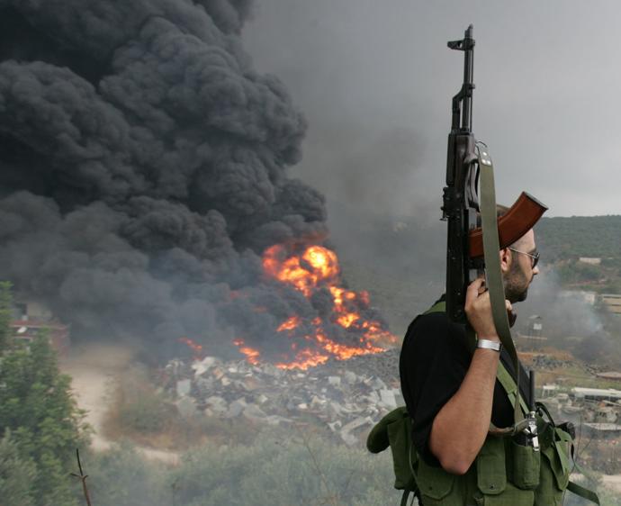 A Lebanese Hezbollah guerrilla (Reuters / Issam Kobeisi)