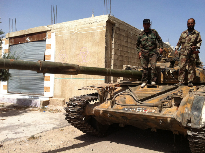 Syrian army soldiers standing on an army tank in the village of Buweida, north of Qusayr, in Syria's central Homs province (AFP Photo / Str)