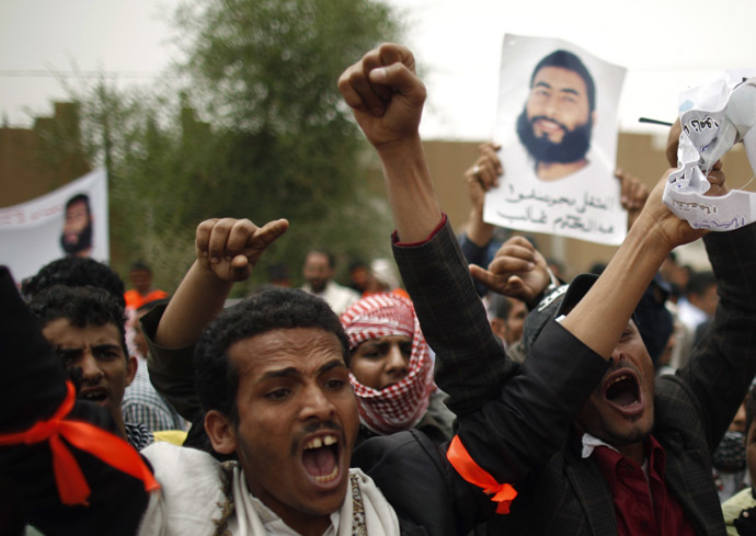 Relatives of Yemeni detainees at the Guantanamo Bay prison shout slogans during a protest to demand the release of the detainees, outside the U.S. embassy in Sanaa June 17, 2013. (Reuters / Khaled Abdullah Ali Al Mahdi)