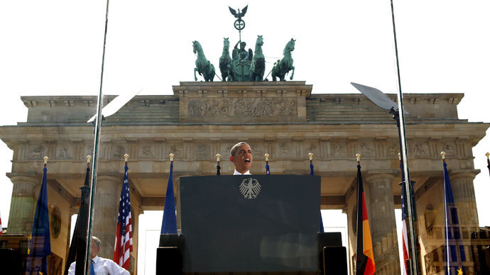 From behind a bullet-proof glass, U.S. President Barack Obama speaks in front of the Brandenburg Gate in Berlin, Germany June 19, 2013. (Reuters / Kevin Lamarque)
