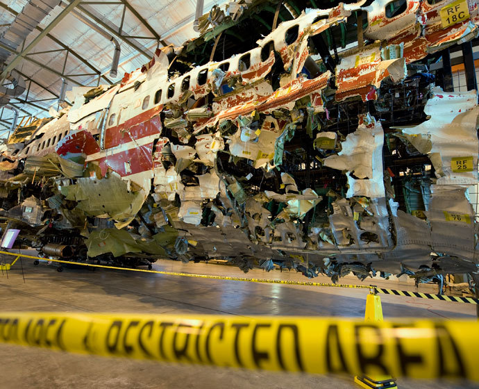 The re-assembled shell of TWA flight #800 sits inside a hangar at the National Transportation Safety Board (NTSB) training facility during a press conference July 16, 2008 in Ashburn, Virginia.(AFP Photo / Paul J. Richards)