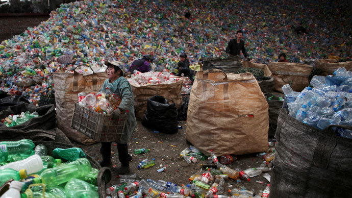 What a waste! London suburb residents fume in face of 40ft rubbish mountain