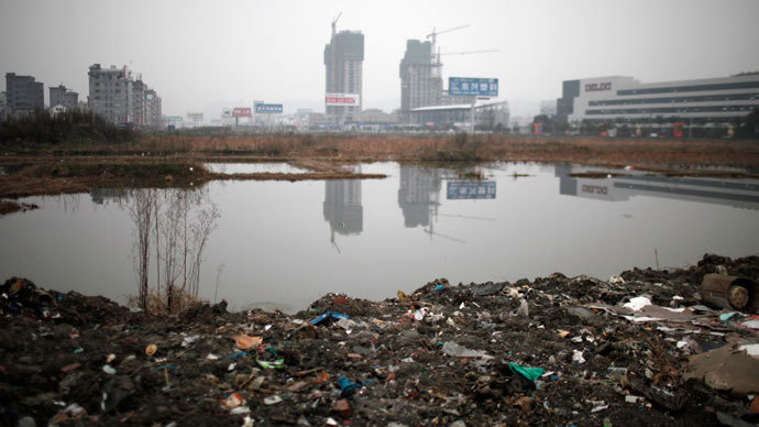 Polluted waters are seen at an industrial area of Wenzhou, in Zhejiang.(Reuters / Carlos Barria)