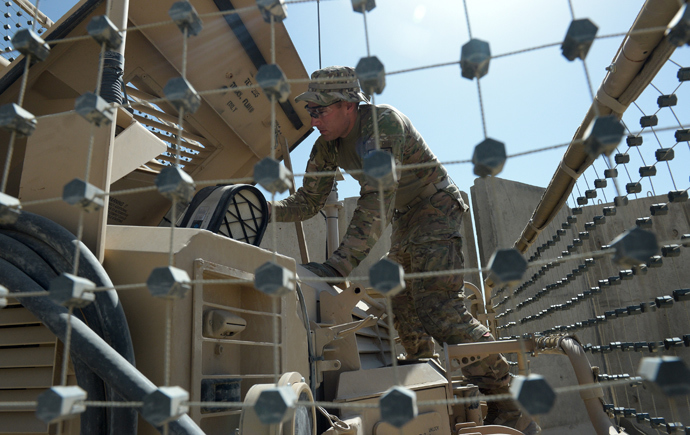 An US soldier from the 10th Mountain Division checks a Maxxpro Mine Resistant Ambush Protected vechile prior to going on an operation at the Forward Operating Base Ghazni (AFP Photo / Dibyangshu Sarkar)