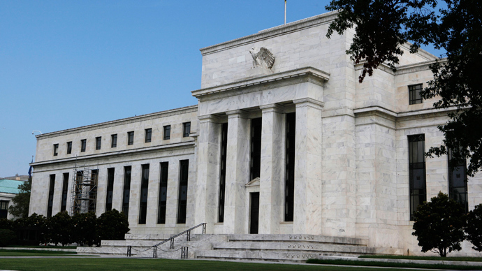 US Fed's plan to end bond purchases drags markets down