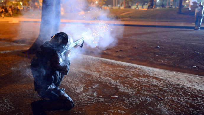 Protester killed, dozens injured as Brazil police face off with a million in 100 cities 10
