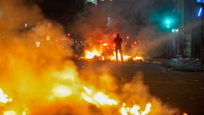 Protester killed, dozens injured as Brazil police face off with a million in 100 cities 15