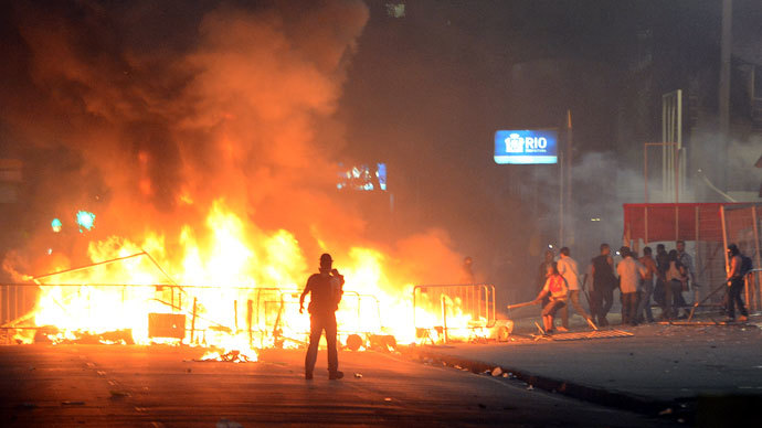 Protester killed, dozens injured as Brazil police face off with a million in 100 cities 17.si