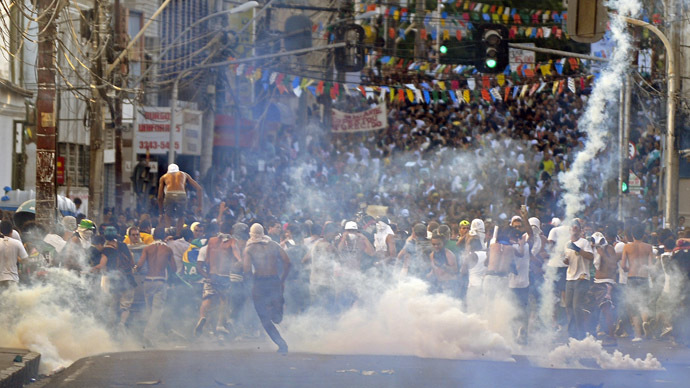 Protester killed, dozens injured as Brazil police face off with a million in 100 cities