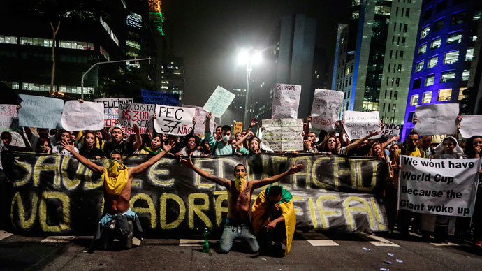 Protester killed, dozens injured as Brazil police face off with a million in 100 cities 6