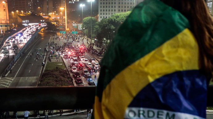 Protester killed, dozens injured as Brazil police face off with a million in 100 cities 8