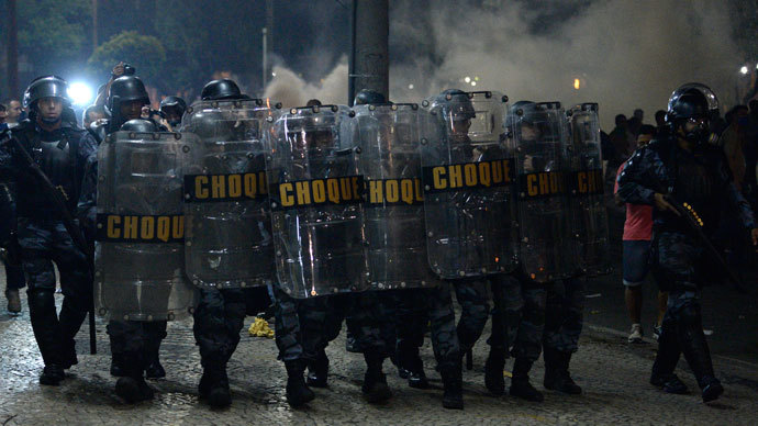 Protester killed, dozens injured as Brazil police face off with a million in 100 cities 9