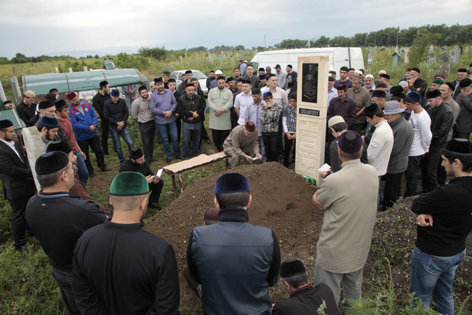 Relatives and friends of Ibragim Todashev, Tsarnaev brothers' friend killed by FBI in Florida, attend his funeral in a Muslim cemetery outside Chechnya's provincial capital Grozny, on June 20, 2013. (AFP Photo)