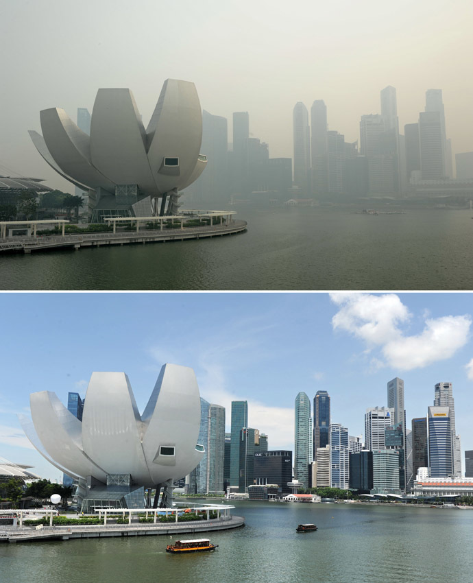 A combination of pictures shows (top) a view of the city skyline shrouded by haze in Singapore on June 20, 2013 and a file picture (bottom) showing the same view on a clear day taken on April 13, 2012. (AFP Photo)