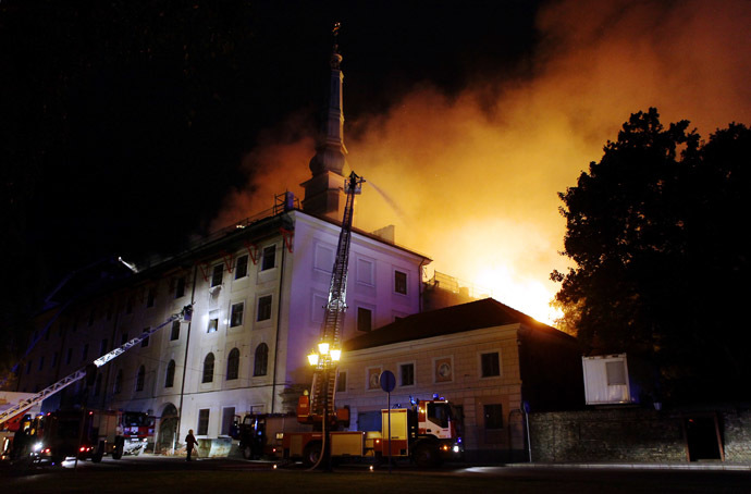 Firefighters put out a fire burning at Riga Castle in Riga on June 20, 2013. (AFP Photo)
