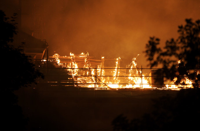 A fire blazes at Riga Castle on June 20, 2013 in Riga, Latvia. (AFP Photo)
