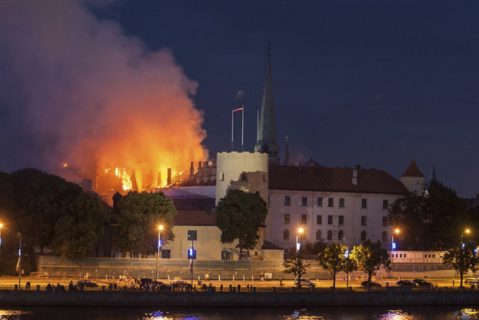A view of the fire at the Riga castle June 20, 2013. According to media reports, the cause of the fire, which started on Thursday night, is unknown. (Reuters/Dmitrijs Sulzics)