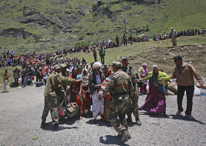 Soldiers stop survivors from going near an army helicopter as its lands during rescue operations at Badrinath in the Himalayan state of Uttarakhand June 21, 2013 (Reuters/Danish Siddiqu)