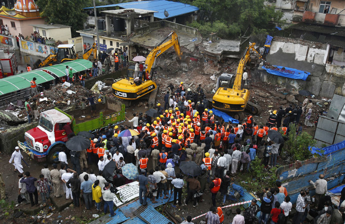Rescue workers use excavators to scour the debris for survivors at the site of a collapsed residential building in Mumbra, in Thane district, on the outskirts of Mumbai June 21, 2013 (Reuters/Vivek Prakash)